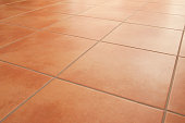 Terracotta floor tiles clean background diminishing perspective