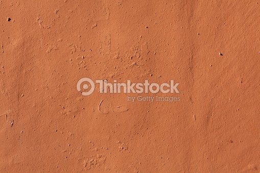Terracotta Painted Stucco Wall Background Texture Stock Photo