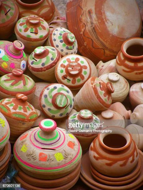 Terracotta pottery is on sale at a street of Karachi