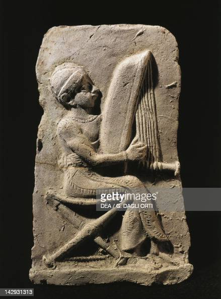 terracotta relief depicting a harp player pictures