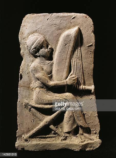Terracotta relief depicting a harp player Babylonian civilisation 2nd Millennium BC Paris Musée Du Louvre