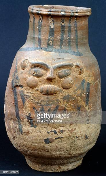 Terracotta vase depicting the God Bes Valley of the Golden Mummies Bahariya Oasis Giza Egypt Egyptian Civilisation 1st century AD