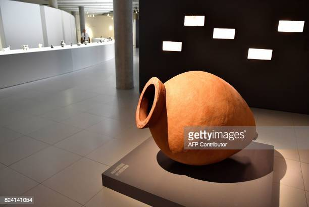 A terracotta wine jar or kvevris from Georgia sits on display at an exhibition at The Cité du Vin in Bordeaux on July 28 2017 Georgia said to be the...