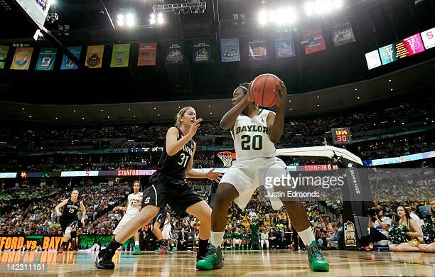 Terran Condrey of the Baylor Bears looks to pass in the second half against Toni Kokenis of the Stanford Cardinal during the National Semifinal game...