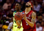 Terran Petteway of the Nebraska Cornhuskers and Gary Franklin of the Baylor Bears react to a play in the first half during the second round of the...
