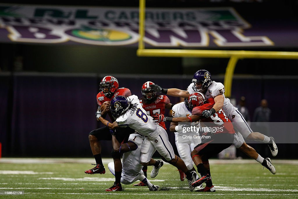 Terrance Broadway #8 of the Louisiana-Lafayette Ragin Cajuns is tackled by Jacobi Jenkins #8of the East Carolina Pirates during the R+L Carriers New Orleans Bow at the Mercedes-Benz Superdome on December 22, 2012 in New Orleans, Louisiana.