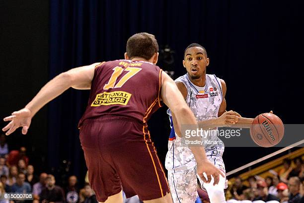 Terrance Ferguson of Adelaide takes on the defence during the round two NBL match between the Brisbane Bullets and the Adelaide 36ers on October 16...