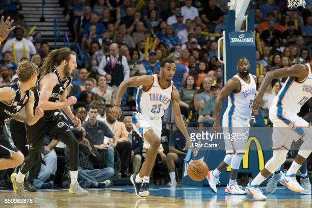 Terrance Ferguson of the Oklahoma City Thunder brings the ball up court against Melbourne United during the first half of a NBA preseason game at the...