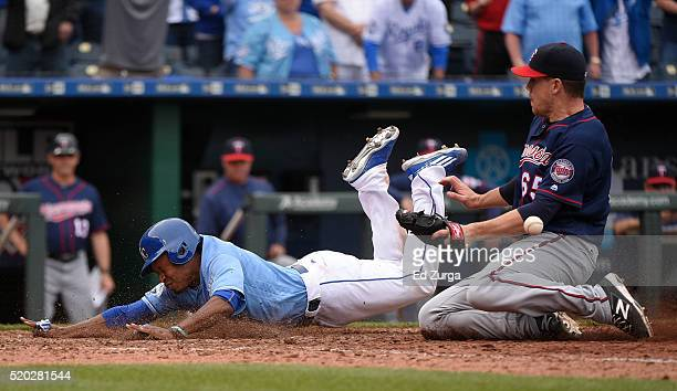 Terrance Gore of the Kansas City Royals slides into home to score the gamewinning run against Trevor May of the Minnesota Twins in the 10th inning at...