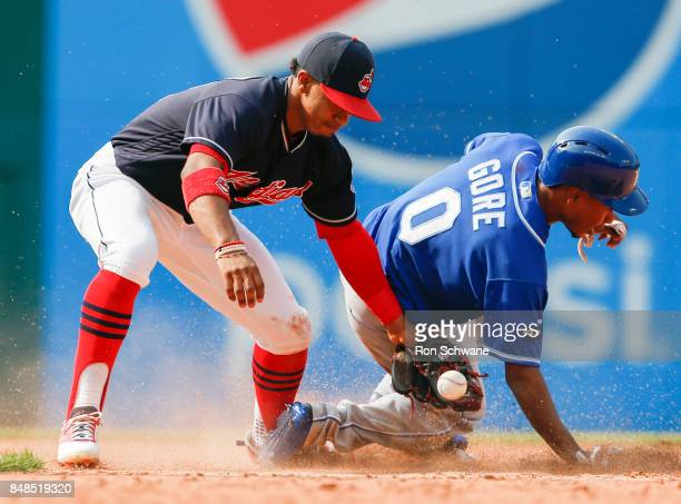 Terrance Gore of the Kansas City Royals steals second base as the ball gets away from Francisco Lindor of the Cleveland Indians during the eighth...