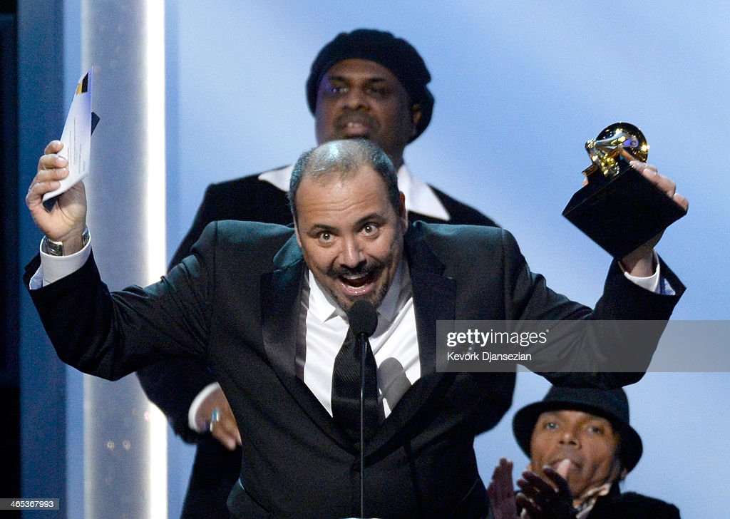 <a gi-track='captionPersonalityLinkClicked' href=/galleries/search?phrase=Terrance+Simien&family=editorial&specificpeople=4230684 ng-click='$event.stopPropagation()'>Terrance Simien</a> accepts the Grammy for Best Regional Roots Award onstage during the 56th GRAMMY Awards Pre-Telecast Show at Nokia Theatre L.A. Live on January 26, 2014 in Los Angeles, California.