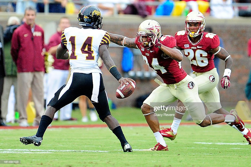 Terrance Smith #24 of the Florida State Seminoles pressures Quentin Williams #14 of the Bethune-Cookman Wildcats during a game at Doak Campbell Stadium on September 21, 2013 in Tallahassee, Florida.