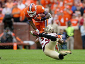 Terrance Smith of the Florida State Seminoles tackles Wayne Gallman of the Clemson Tigers during their game at Memorial Stadium on November 7 2015 in...