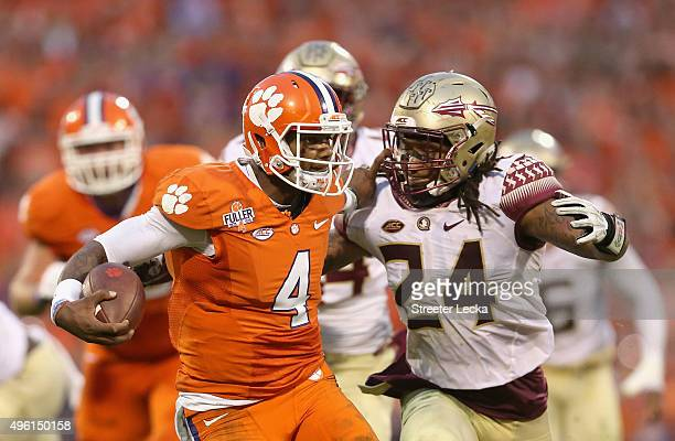 Terrance Smith of the Florida State Seminoles tries to tackle Deshaun Watson of the Clemson Tigers during their game at Memorial Stadium on November...