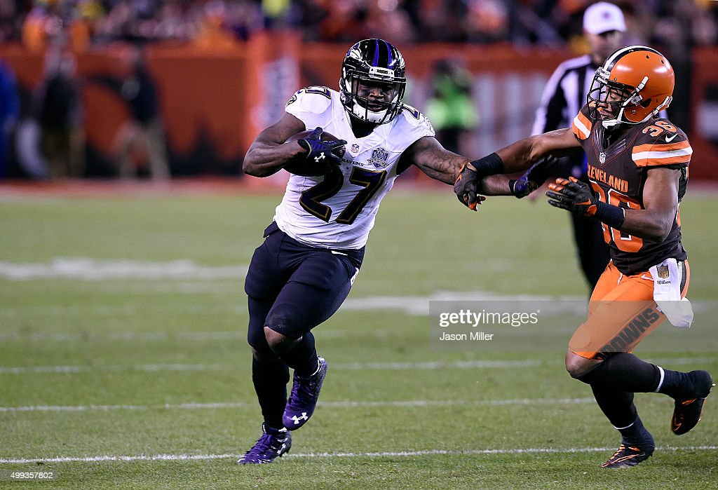 <a gi-track='captionPersonalityLinkClicked' href=/galleries/search?phrase=Terrance+West&family=editorial&specificpeople=8363311 ng-click='$event.stopPropagation()'>Terrance West</a> #27 of the Baltimore Ravens carries the ball in front of <a gi-track='captionPersonalityLinkClicked' href=/galleries/search?phrase=K%27Waun+Williams&family=editorial&specificpeople=8222224 ng-click='$event.stopPropagation()'>K'Waun Williams</a> #36 of the Cleveland Browns during the fourth quarter at FirstEnergy Stadium on November 30, 2015 in Cleveland, Ohio.