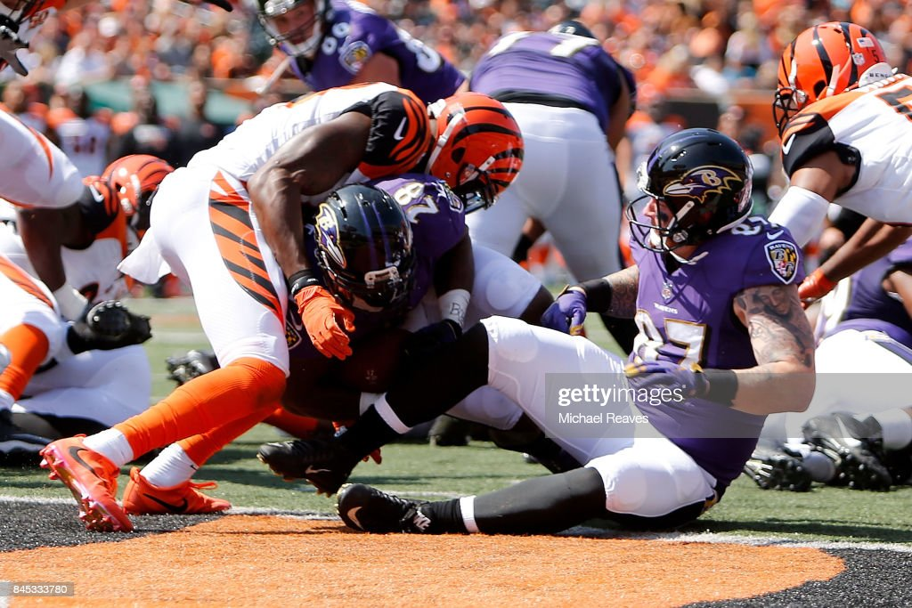 00dbef210 ... NFL Limited Rush Fashion Jersey Terrance West 28 of the Baltimore Ravens  runs through George Iloka 43 of the .