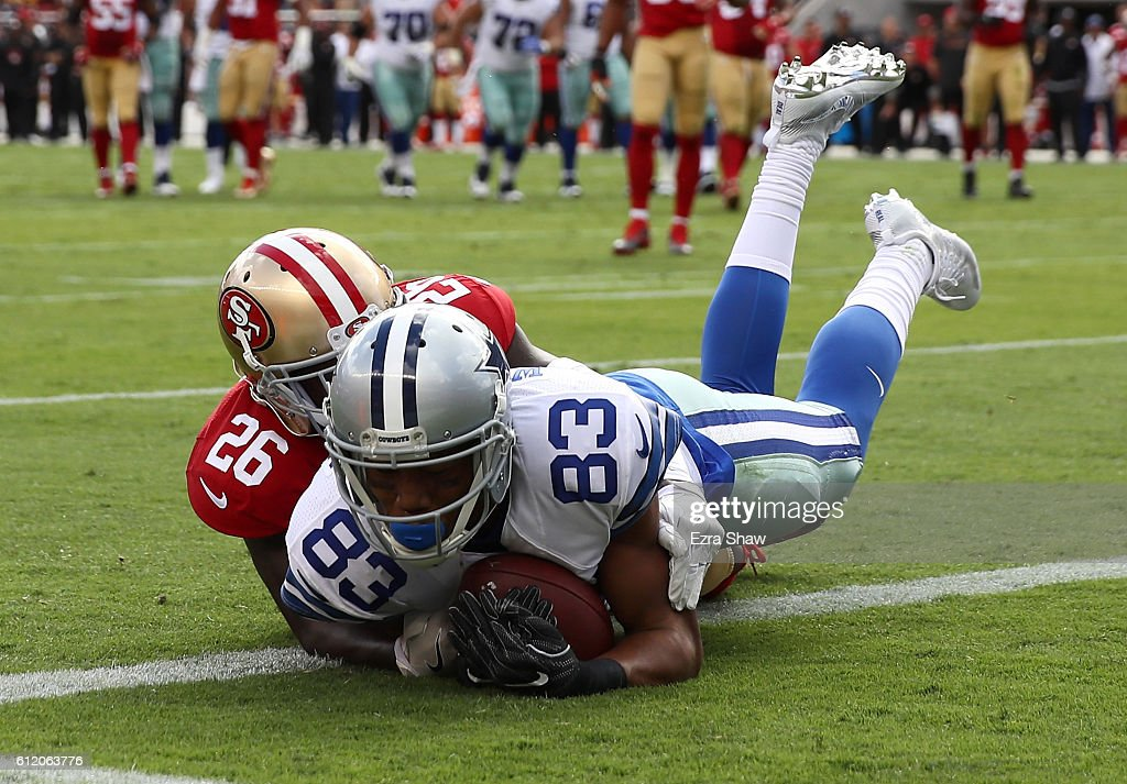 Terrance Williams #83 of the Dallas Cowboys makes a leaping catch for a touchdown against Tramaine Brock #26 of the San Francisco 49ers during the second quarter at Levi's Stadium on October 2, 2016 in Santa Clara, California.