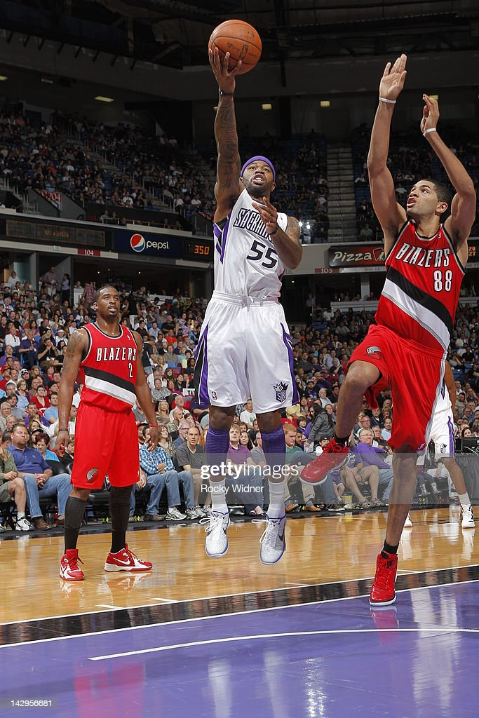 Terrance Williams #55 of the Sacramento Kings shoots the ball against <a gi-track='captionPersonalityLinkClicked' href=/galleries/search?phrase=Nicolas+Batum&family=editorial&specificpeople=3746275 ng-click='$event.stopPropagation()'>Nicolas Batum</a> #88 of the Portland Trail Blazers on April 15, 2012 at Power Balance Pavilion in Sacramento, California.