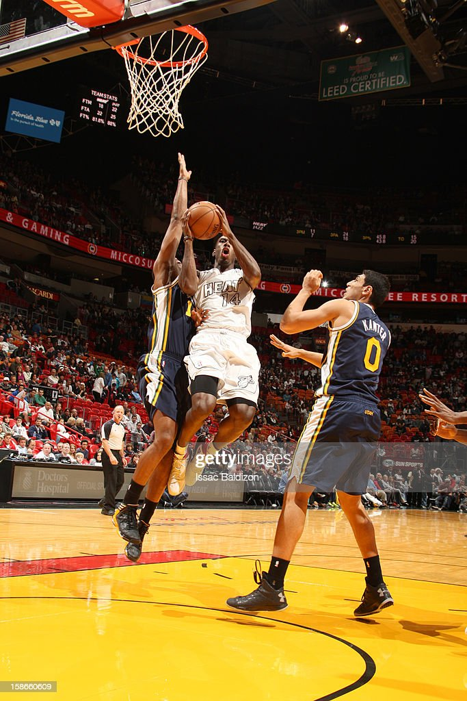 <a gi-track='captionPersonalityLinkClicked' href=/galleries/search?phrase=Terrel+Harris&family=editorial&specificpeople=835465 ng-click='$event.stopPropagation()'>Terrel Harris</a> #14 of the Miami Heat goes to the basket during the game between the Utah Jazz and the Miami Heat on December 22, 2012 at American Airlines Arena in Miami, Florida.