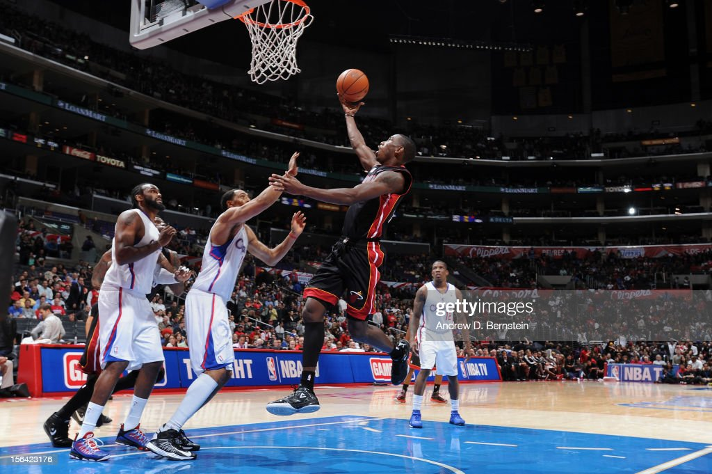<a gi-track='captionPersonalityLinkClicked' href=/galleries/search?phrase=Terrel+Harris&family=editorial&specificpeople=835465 ng-click='$event.stopPropagation()'>Terrel Harris</a> #14 of the Miami Heat shoots a layup against <a gi-track='captionPersonalityLinkClicked' href=/galleries/search?phrase=Ryan+Hollins&family=editorial&specificpeople=182556 ng-click='$event.stopPropagation()'>Ryan Hollins</a> #15 of the Los Angeles Clippers at the Staples Center on November 14, 2012 in Los Angeles, California.