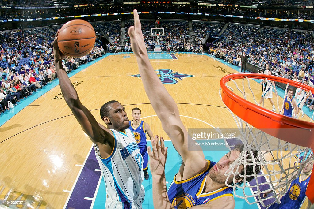 Terrel Harris #12 of the New Orleans Hornets attempts a dunk against Andrew Bogut #12 of the Golden State Warriors on March 18, 2013 at the New Orleans Arena in New Orleans, Louisiana.