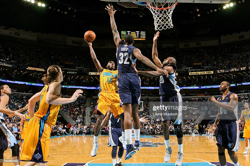 Terrel Harris #12 of the New Orleans Hornets attempts a layup against Ed Davis #32 and Quincy Pondexter #20 of the Memphis Grizzlies on March 22, 2013 at the New Orleans Arena in New Orleans, Louisiana.