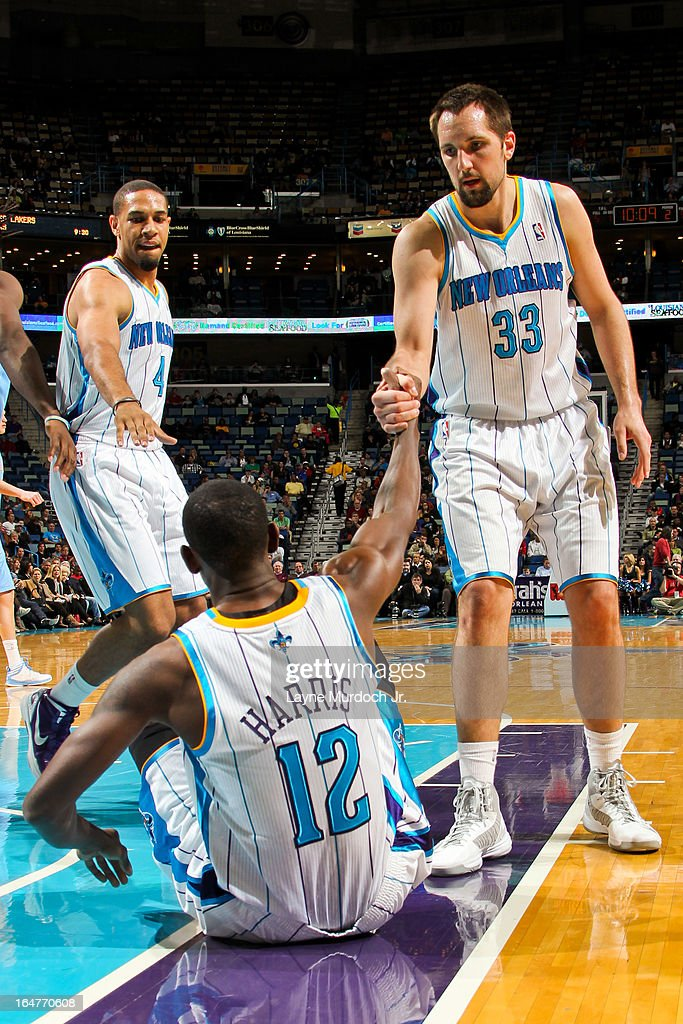 Terrel Harris #12 of the New Orleans Hornets is helped up by teammates Ryan Anderson #33 and Xavier Henry #4 during a game against the Denver Nuggets on March 25, 2013 at the New Orleans Arena in New Orleans, Louisiana.