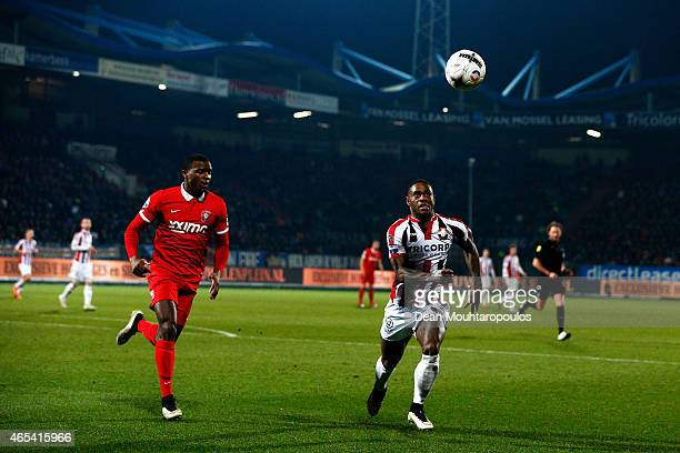 Terrel Ondaan of Willem II chases the ball with Cuco Martina of Twente during the Dutch Eredivisie match between Willem II Tilburg and FC Twente held...
