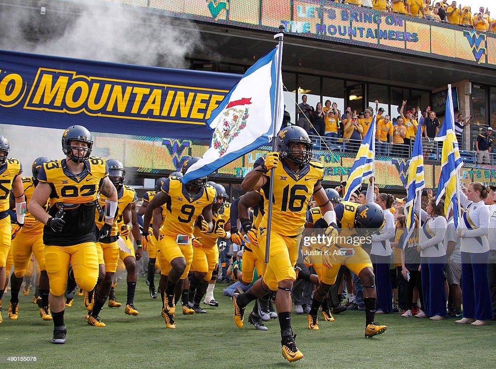 Terrell Chestnut leads the West Virginia Mountaineers onto the field before the game against the Maryland Terrapins on September 26 2015 at...