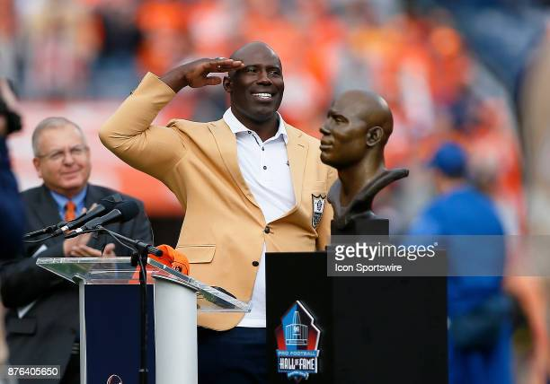 Terrell Davis salutes the Broncos fans after being honored with his Hall of Fame induction prior to a game between the Denver Broncos and the...