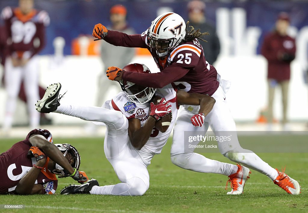 Terrell Edmunds #25 of the Virginia Tech Hokies hits Dominique Reed #3 of the Arkansas Razorbacks during the Belk Bowl at Bank of America Stadium on December 29, 2016 in Charlotte, North Carolina.