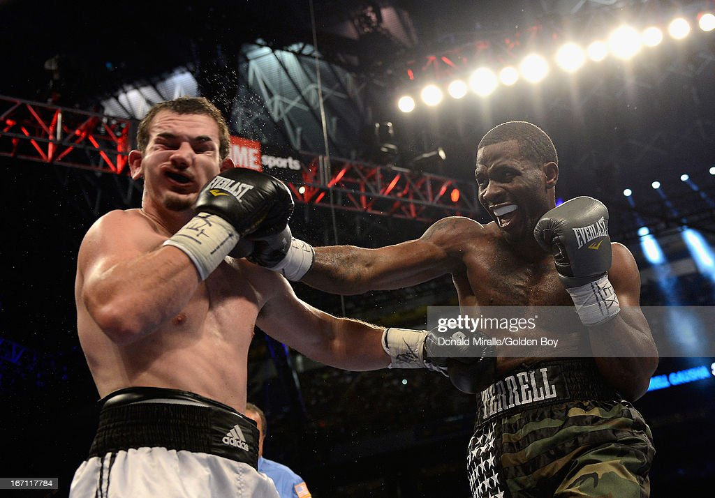 Terrell Gausha lands a punch to the face of William Walters (L) during their Super Middleweight Bout at Alamodome on April 20, 2013 in San Antonio, Texas.