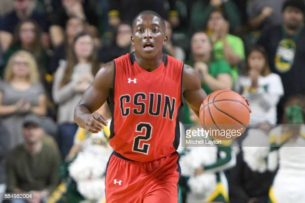 Terrell Gomez of the Cal State Northridge Matadors dribbles up court during a college basketball tournament against the George Mason Patriots at the...