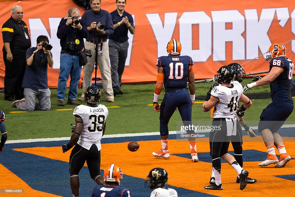 Terrell Hunt #10 of Syracuse Orange looks to the crowd after scoring the team's first touchdown during the third quarter of a football game against Wake Forest Demon Deacons on November 2, 2013 at the Carrier Dome in Syracuse, New York. Syracuse shuts out Wake Forest 13-0