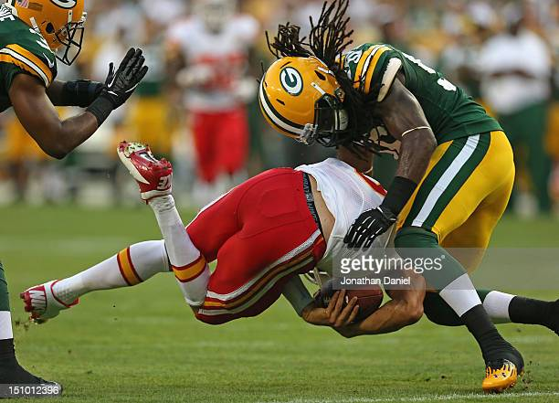 Terrell Manning of the Green Bay Packers brings down Brady Quinn of the Kansas City Chiefs during a preseason game at Lambeau Field on August 30 2012...