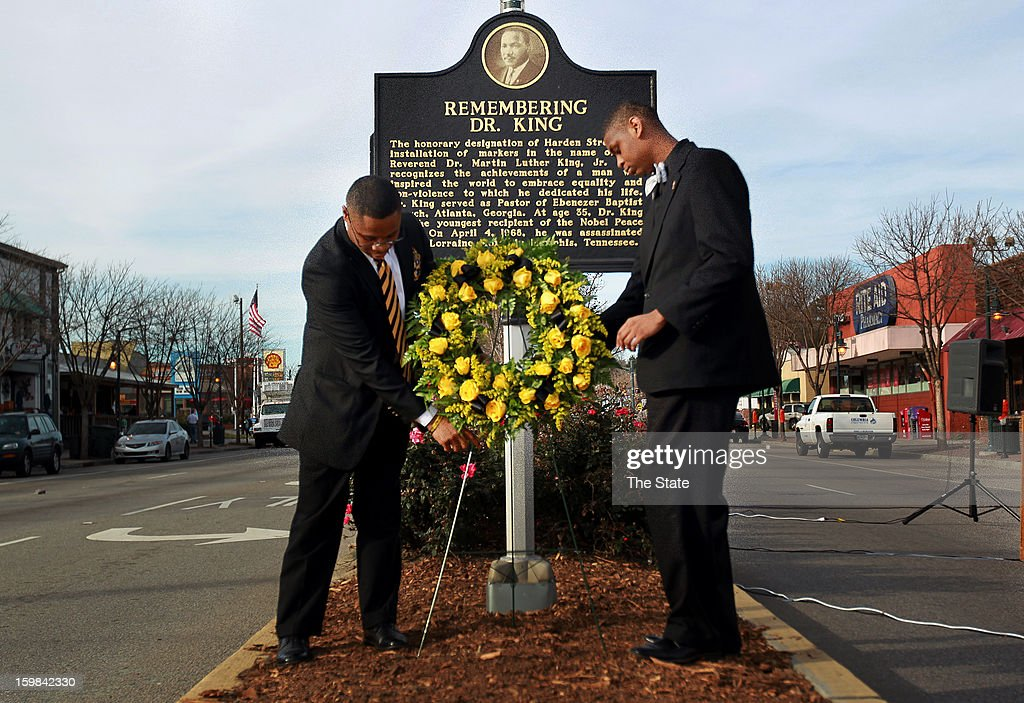 Terrell McCombs, left, and Terrence Hickman place a wreath at the intersection of Harden and Greene in honor of Dr. Martin Luther King Jr., Monday, January 21, 2013, in Columbia, South Carolina.