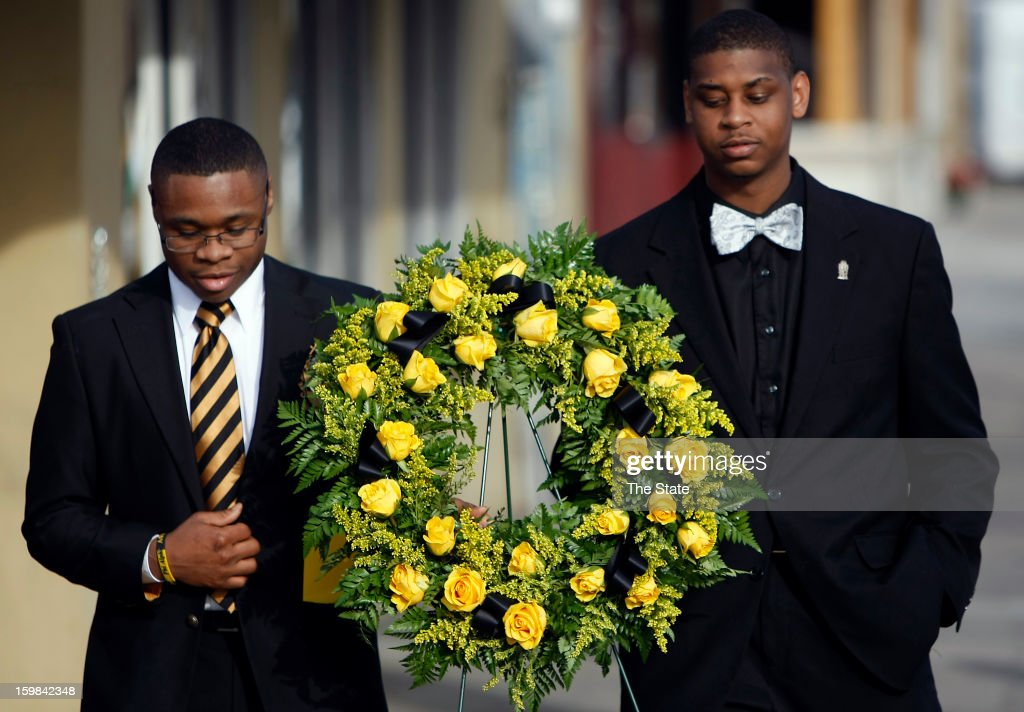 Terrell McCombs, left, and Terrence Hickman prepare to place a wreath at the intersection of Harden and Greene in honor of Dr. Martin Luther King Jr., Monday, January 21, 2013, in Columbia, South Carolina.
