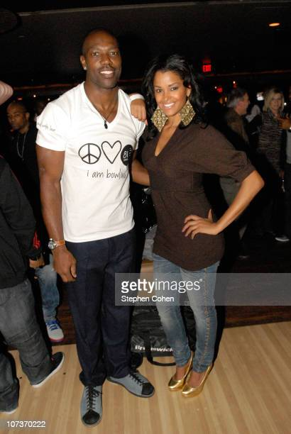Terrell Owens and Claudia Jordan attend the 81 Cares Bowl presented by Terrell Owens and GQ Magazine at Star Lanes On The Levee on December 6 2010 in...