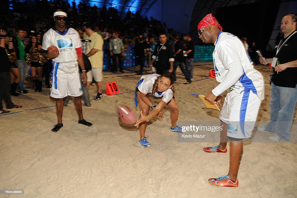 Terrell Owens, Lolo Jones, and Deion Sanders attend DIRECTV'S 7th annual celebrity Beach Bowl at DTV SuperFan Stadium at Mardi Gras World on February 2, 2013 in New Orleans, Louisiana.
