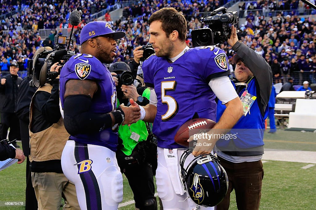 Terrell Suggs #55 and Joe Flacco #5 of the Baltimore Ravens celebrate following the Ravens 20-10 win over the Cleveland Browns at M&T Bank Stadium on December 28, 2014 in Baltimore, Maryland.