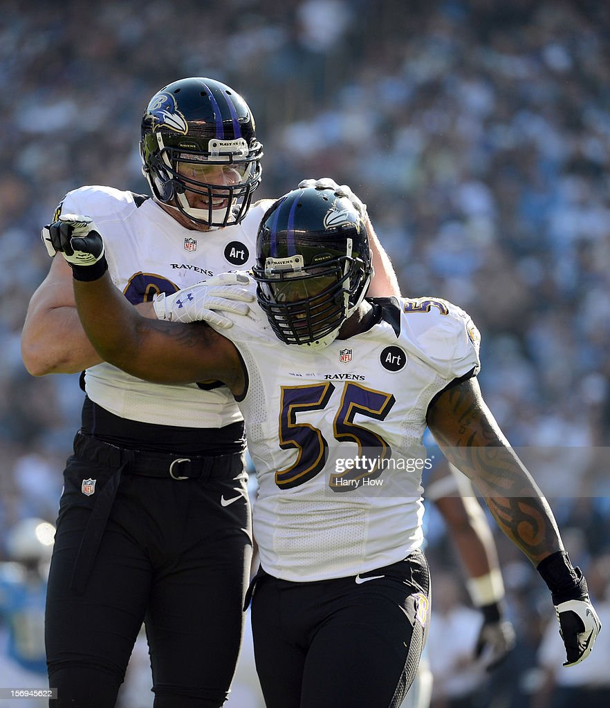 Terrell Suggs #55 and Paul Kruger #99 of the Baltimore Ravens celebrate a defensive stop on third down against the San Diego Chargers at Qualcomm Stadium on November 25, 2012 in San Diego, California.
