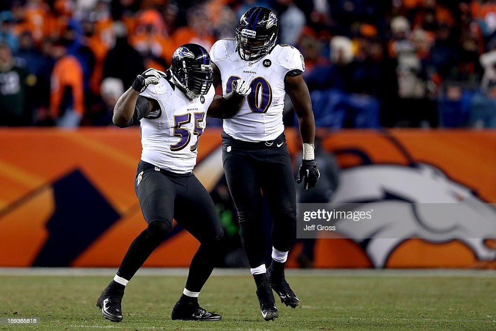 Terrell Suggs #55 and Pernell McPhee #90 of the Baltimore Ravens react to a defensive stop against the Denver Broncos in the second half against the Denver Broncos during the AFC Divisional Playoff Game at Sports Authority Field at Mile High on January 12, 2013 in Denver, Colorado.