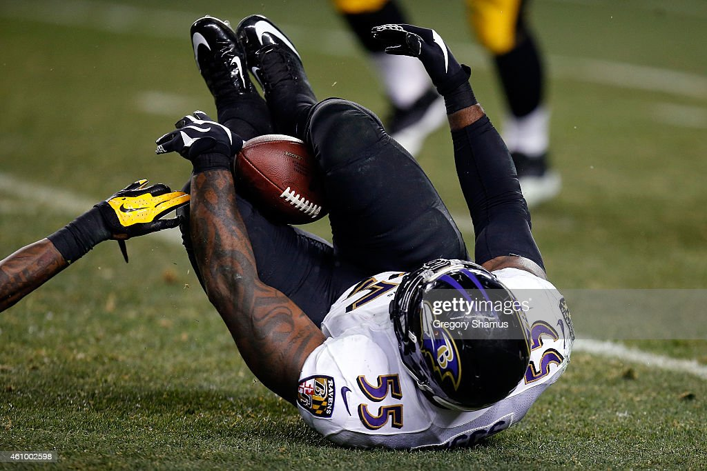 Terrell Suggs of the Baltimore Ravens catches an interception between his legs in the fourth quarter against the Pittsburgh Steelers during their AFC...