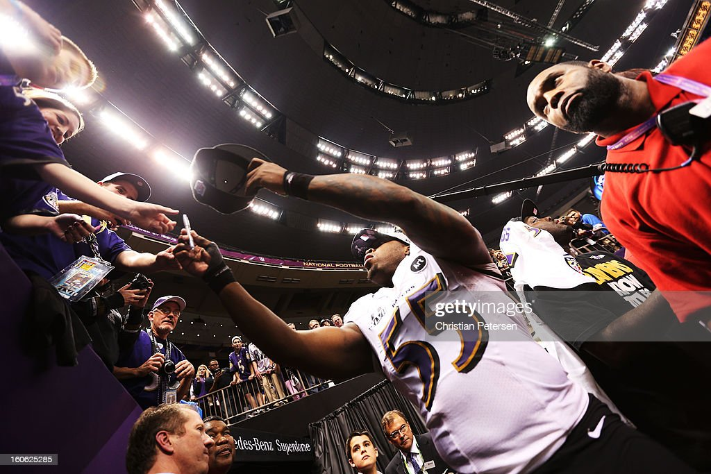 Terrell Suggs #55 of the Baltimore Ravens celebrates with fans as he walks off of the field after the Ravens won 34-31 against the San Francisco 49ers during Super Bowl XLVII at the Mercedes-Benz Superdome on February 3, 2013 in New Orleans, Louisiana.