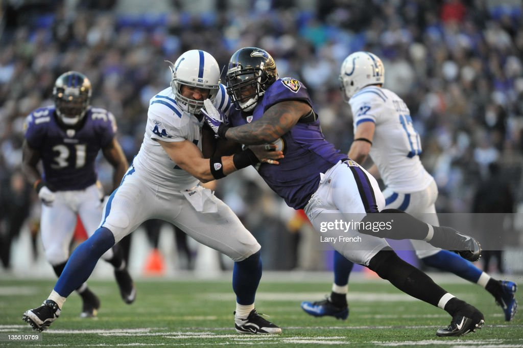 <a gi-track='captionPersonalityLinkClicked' href=/galleries/search?phrase=Terrell+Suggs&family=editorial&specificpeople=215464 ng-click='$event.stopPropagation()'>Terrell Suggs</a> #55 of the Baltimore Ravens defends against <a gi-track='captionPersonalityLinkClicked' href=/galleries/search?phrase=Dallas+Clark&family=editorial&specificpeople=184501 ng-click='$event.stopPropagation()'>Dallas Clark</a> #44 of the Indianapolis Colts at M&T Bank Stadium on December 11, 2011 in Baltimore, Maryland. The Ravens defeated the Colts 24-10.