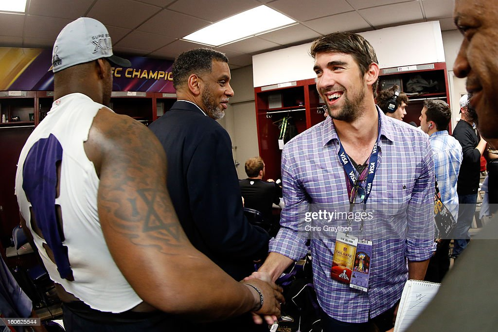 Terrell Suggs #55 of the Baltimore Ravens shakes hands with Olympic gold medalist Michael Phelps in the locker room after the Ravens defeated the San Francisco 49ers during Super Bowl XLVII at the Mercedes-Benz Superdome on February 3, 2013 in New Orleans, Louisiana. The Ravens defeated the 49ers 34-31.