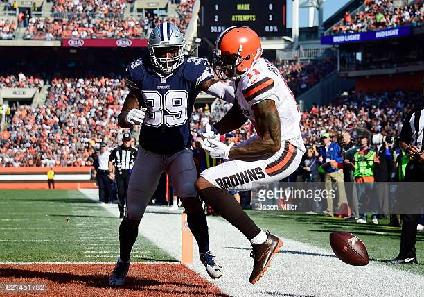 Terrelle Pryor of the Cleveland Browns drops a pass in the first half against Brandon Carr of the Dallas Cowboys at FirstEnergy Stadium on November 6...