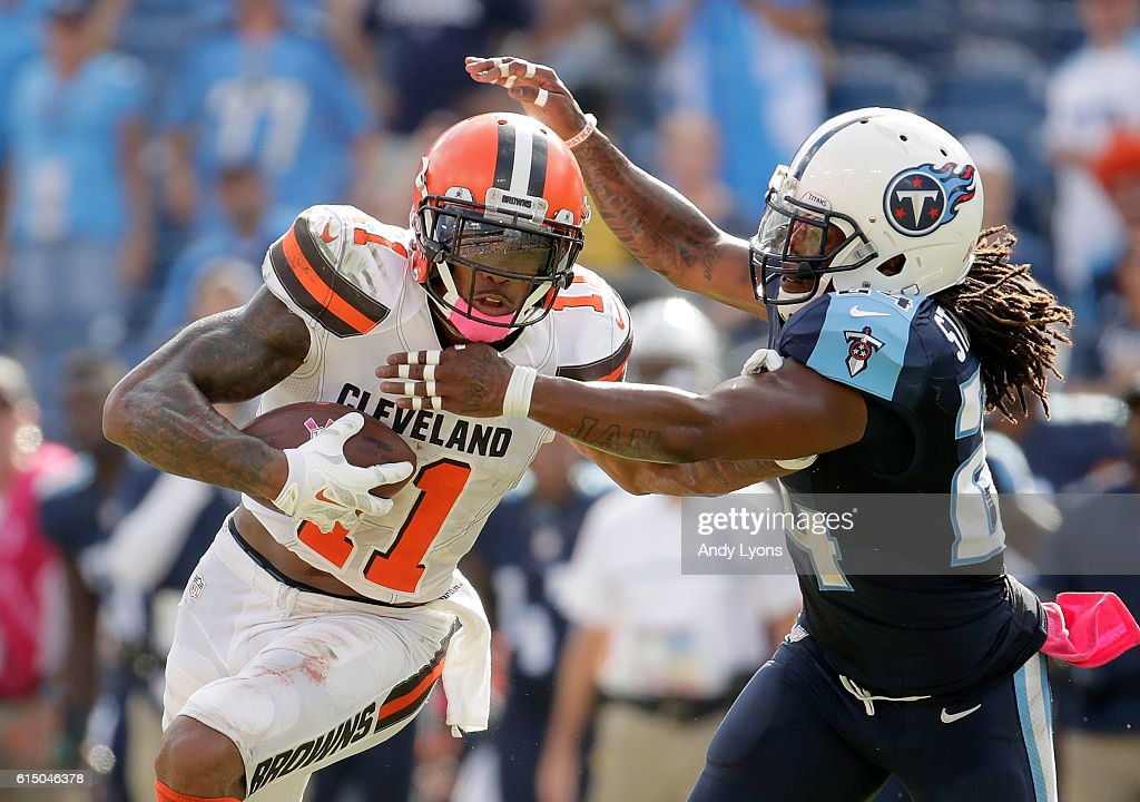 Terrelle Pryor #11 of the Cleveland Browns runs with the ball while defended by Daimion Stafford #24 of the Tennessee Titans at Nissan Stadium on October 16, 2016 in Nashville, Tennessee.
