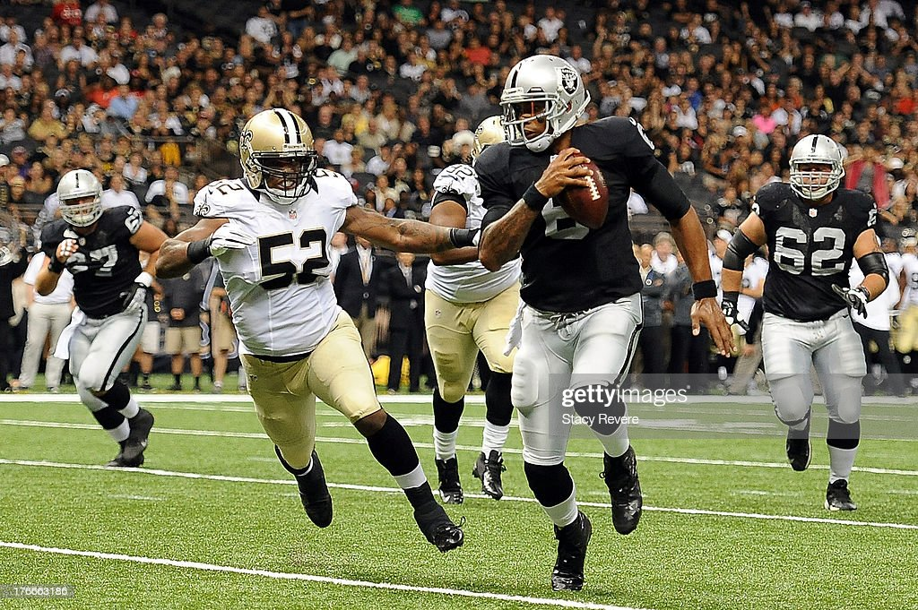<a gi-track='captionPersonalityLinkClicked' href=/galleries/search?phrase=Terrelle+Pryor&family=editorial&specificpeople=4420918 ng-click='$event.stopPropagation()'>Terrelle Pryor</a> #6 of the Oakland Raiders is pursued by Kevin Reddick #52 of the New Orleans Saints during a preseason game at the Mercedes-Benz Superdome on August 16, 2013 in New Orleans, Louisiana.