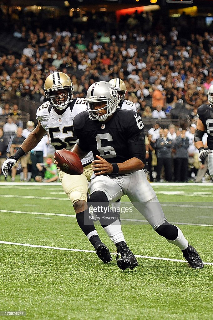 Terrelle Pryor #6 of the Oakland Raiders scrambles for yards against the New Orleans Saints during a preseason game at the Mercedes-Benz Superdome on August 16, 2013 in New Orleans, Louisiana. The Saints won 28-20.